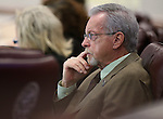 Nevada Assemblyman Glenn Trowbridge, R-Las Vegas, works in committee at the Legislative Building in Carson City, Nev., on Wednesday, Feb. 25, 2015. <br /> Photo by Cathleen Allison