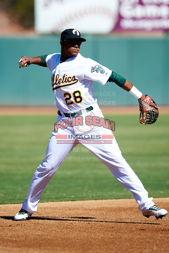 Phoenix Desert Dogs third baseman Yordy Cabrera #28, of the Oakland Athletics organization, during an Arizona Fall League game against the Mesa Solar Sox at Phoenix Municipal Stadium on October 19, 2012 in Phoenix, Arizona.  Phoenix defeated Mesa 10-6.  (Mike Janes/Four Seam Images)