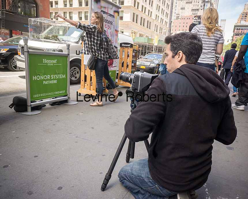 A videographer uses a Blackmagic camera in New York on Monday, June 13, 2016. (© Richard B. Levine)