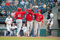 Springfield Cardinals outfielder Johan Mieses (41) (from left) is congratulated by Randy Arozarena (37) and Evan Mendoza (4) after hitting a three-run home run on May 16, 2019, at Arvest Ballpark in Springdale, Arkansas. (Jason Ivester/Four Seam Images)
