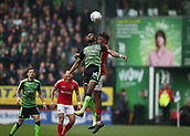 24th March 2018, The Valley, London, England;  English Football League One, Charlton Athletic versus Plymouth Argyle; Joe Aribo of Charlton Athletic heads the ball over Moses Makasi of Plymouth Argyle