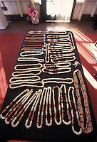 Table displaying rare and valuable Niihau Shell Necklaces