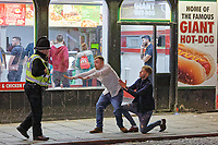 Pictured: A police officer speaks to two male revellers in Wind Street, Swansea. Monday 31 December 2018 and Tuesday 01 January 2019<br /> Re: New Year revellers in Wind Street, Swansea, Wales, UK