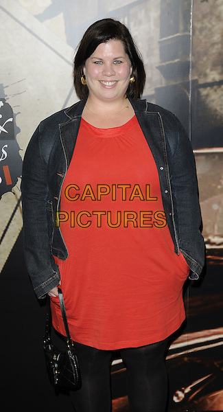 KATY BRAND .At the Specsavers Crime Thriller Awards 2010, Grosvenor House Hotel,  Park Lane, London, England, UK, .8th October 2010..half length black red dress denim jacket tights .CAP/CAN.©Can Nguyen/Capital Pictures.