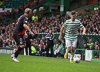 Charlie Mulgrew being watched by Gary Teale in the Celtic v St Mirren Clydesdale Bank Scottish Premier League match played at Celtic Park, Glasgow on 15.12.12.