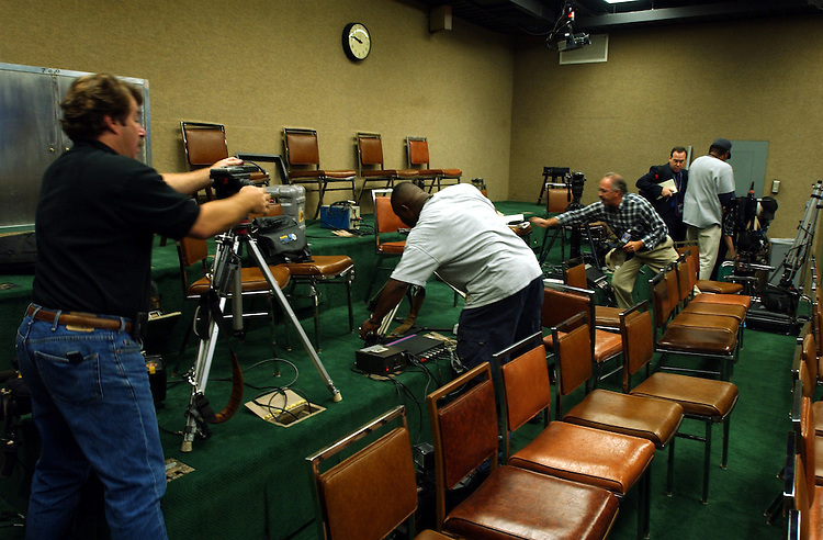 studio091101 --Camera crews in the Senate Studio gather their equipment shortly before the Capitol was evacuated.