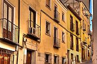 Rustc houses and narrow cobblestone street, Madrid, Spain