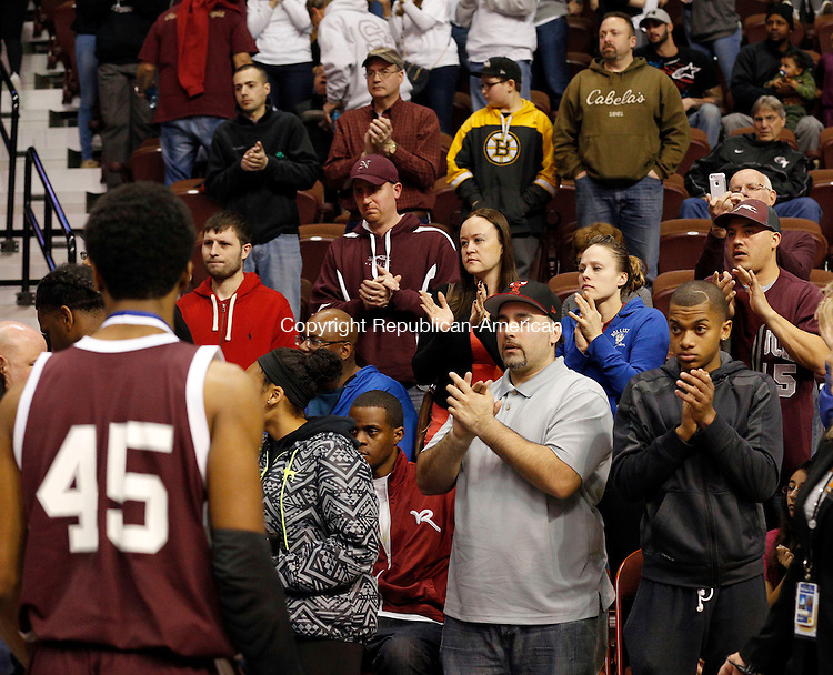 Uncasville, CT- 22 March 2015-032215CM41- Naugatuck fans show their support as the boys basketball team walk off the court after falling to Bunnell 72-61 in the Class L state championship game at Mohegan Sun Arena in Uncasville on Sunday.     Christopher Massa Republican-American