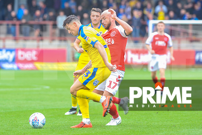 Fleetwood Town's forward Patrick Madden (17) battles with Wimbledon's defender Luke O'Neil (2) during the Sky Bet League 1 match between Fleetwood Town and AFC Wimbledon at Highbury Stadium, Fleetwood, England on 10 August 2019. Photo by Stephen Buckley / PRiME Media Images.