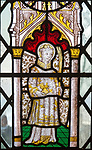 Church of Saint Mary of the Assumption, Ufford, Suffolk, England, UK fifteenth century stained glass window of Saint Stephen