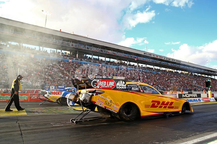 Nov 2, 2014; Las Vegas, NV, USA; NHRA funny car driver Del Worsham (near) defeats Matt Hagan during the Toyota Nationals at The Strip at Las Vegas Motor Speedway. Mandatory Credit: Mark J. Rebilas-USA TODAY Sports
