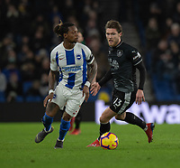 Brighton &amp; Hove Albion's Gaetan Bong (left) under pressure from Burnley's Jeff Hendrick (right) <br /> <br /> Photographer David Horton/CameraSport<br /> <br /> The Premier League - Brighton and Hove Albion v Burnley - Saturday 9th February 2019 - The Amex Stadium - Brighton<br /> <br /> World Copyright &copy; 2019 CameraSport. All rights reserved. 43 Linden Ave. Countesthorpe. Leicester. England. LE8 5PG - Tel: +44 (0) 116 277 4147 - admin@camerasport.com - www.camerasport.com