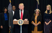 United States President Donald Trump delivers remarks after touring the Smithsonian National Museum of African American History & Culture in Washington, D.C. on February 21, 2017. Trump was joined by Dr. Ben Carson (2nd-L), Carson's wife Candy (L), Alveda King (2nd-R), niece of Martin Luther King Jr. and Ivanka Trump. <br /> Credit: Kevin Dietsch / Pool via CNP