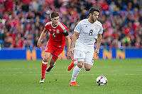 Valeri Kazaishvili of Georgia gets past Ben Davies of Wales during the FIFA World Cup Qualifier match between Wales and Georgia at the Cardiff City Stadium, Cardiff, Wales on 9 October 2016. Photo by Mark  Hawkins / PRiME Media Images.