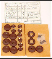 BNPS.co.uk (01202 558833)Pic: Astons/BNPS<br /> <br /> Replacement buttons - Snappy Suit.<br /> <br /> Cold War Collectables - Auction of Soviet spy camera's from behind the Iron Curtain reveal the KGB's cunning and ingenuity at the height of the Cold War.<br /> <br /> A fascinating collection of Russian spy cameras which were used clandestinely at the height of the Cold War have emerged for sale for &pound;60,000.<br /> <br /> The ingenious gadgets deployed by KGB operatives include cameras built into the sides of briefcases, buttons of jackets, umbrella handles and cigarette cases.<br /> <br /> The sale also features a clever 'Zenit' F-21 spy camera which shoots photos through the side of a camera case when it appears to be shut.<br /> <br /> There are also several 'Minox' cameras which are known as the 'James Bond' spy camera as one appeared in the film On Her Majesty's Secret Service (1969).