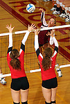 SIOUX FALLS, SD - OCTOBER 25:  Madison Tyler #3 from Roosevelt tries to get a kill past Larissa Trainer #24 and an unidentified defender from Rapid City Central in the third game of their match Friday night at Roosevelt. (Photo by Dave Eggen/Inertia)