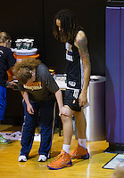 Jun. 10, 2013; Phoenix, AZ, USA: The knee of Phoenix Mercury center Brittney Griner (right) is inspected by a team trainer during a team practice at the US Airways Center. Mandatory Credit: Mark J. Rebilas-
