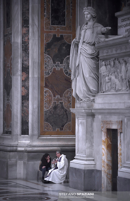 Faithful confesses during the  penitential celebration in St. Peter's Basilica at the Vatican, March 29, 2019