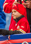 9 November 2014: A Younf Chiefs Fan watches pre-game activity prior to a game between the Kansas City Chiefs and the Buffalo Bills at Ralph Wilson Stadium in Orchard Park, NY. The Chiefs rallied to defeat the Bills 17-13. Mandatory Credit: Ed Wolfstein Photo *** RAW (NEF) Image File Available ***