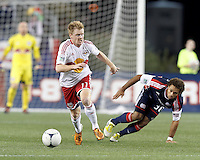 New York Red Bulls midfielder Dax McCarty (11) brings the ball forward. Despite a red-card man advantage, in a Major League Soccer (MLS) match, the New England Revolution tied New York Red Bulls, 1-1, at Gillette Stadium on September 22, 2012.