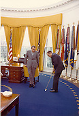 Entertainer Bob Hope shows off his putting to United States President Richard M. Nixon in the Oval Office at the White House in Washington, D.C. on April 20, 1973. .Credit: White House via CNP