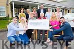 The O'Donoghue Family presenting one of 4 cheques on Monday with this one for €20,000 to St Annes Hospital Cahersiveen pictured front l-r; John McCarthy, Peata O'Donoghue, Mary O'Donoghue, Dr John Shanahan, Lisa Delve, Brian Delve, back l-r; Helen O'Donoghue, Mary Casey, Anne Bowler, Pat Sugrue, Garardine Bowler(Clinical Nurse Manager) & Anne Curran.  The three remaining cheques went to The Oncology Unit Kerry University Hospital €10,000, Recovery Haven €3,000 & South West Hospice €2,000.