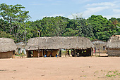 Pará State, Brazil. Aldeia Kikretum. Traditional houses built inside the circle of brick houses built by the loggers.