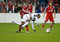 28 September 2010: Real Salt Lake forward Robbie Findley #10  and Toronto FC midfielder Julian de Guzman #6 in action during a CONCACAF Champions League game between Real Salt Lake and Toronto FC at BMO Field in Toronto...
