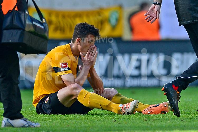 Fussball, 2. Bundesliga, Saison 2013/14, 34. Spieltag, Armina Bielefeld, Sonntag (11.05.14), Dresden, Gluecksgas Stadion. Dresdens Anthony Losilla nach dem Abstieg.