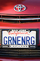 A close up of 'GRNENRG' (Green Energy) license plate on Toyota Prius with a San Jose Capitol frame. Mountain View, California, USA
