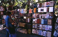 12 FEB 2003 - HAVANA, CUB - Visitors look at books on a stall in the Plaza de Armas (PHOTO (C) NIGEL FARROW