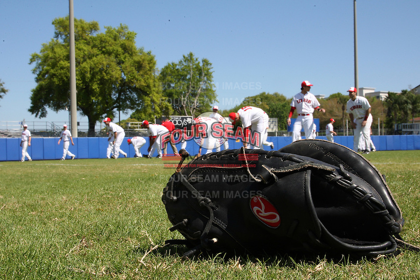 Illinois State Redbirds stretch in the background before a game vs. the Ohio State Buckeyes at Chain of Lakes Park in Winter Haven, Florida;  March 11, 2011.  Illinois defeated Ohio State 12-1.  Photo By Mike Janes/Four Seam Images