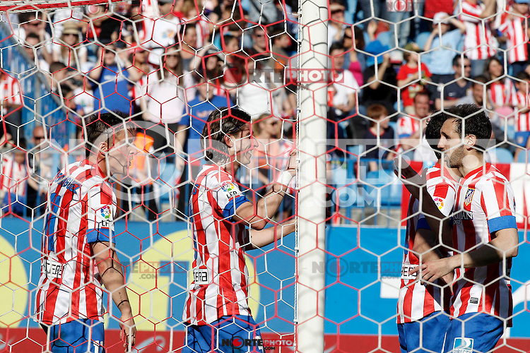 Atletico de Madrid's Cristian Cebolla Rodriguez (l), Filipe Luis (c) and Juanfran Torres celebrate goal during La Liga match.April 14,2013. (ALTERPHOTOS/Acero)