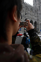 2006 Model Release Photo -<br /> 14 year old chinese teenager take photos of the horse-drawn Caleches in front of Notre-Dame Basilica in Old-Montreal with a small Canon SD-300 Digital camera.