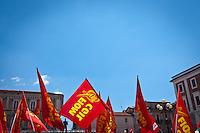 Bandiere rosse della FIOM CGIL in piazza del Duomo durante lo Sciopero Nazionale della CGIL, in Abruzzo il corteo della protesta si è svolta nella zona rossa della città de L'Aquila ad un anno dal terremoto. 25/06/2010 Photo: Adamo Di Loreto/BuenaVista*Photo