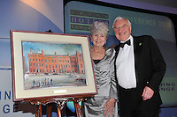 Martin and Carmel Naughton, Entrepreneur, part owner of the Merrion Hotel and founder of Glen Dimplex pictured after receiving a painting of The Merrion Hotel from Michael Vaughan, President IHF at the IHF annual banquet in The Malton Hotel, Killarney. Mr. Naughton received the president's honour for his contribution to Irish business..Picture by Don MacMonagle..