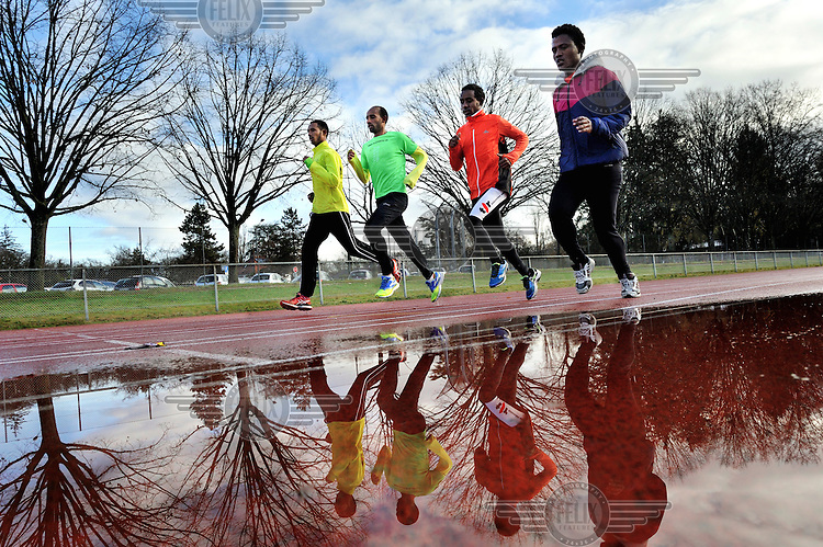 Asylum seekers, Samuel, Daniel, and Berhane from Eritrea, training for the Escalade at the Stade du bout du Monde, with help from Tesfay Felselfel (wearing green), who is originally from Eritrea himself.