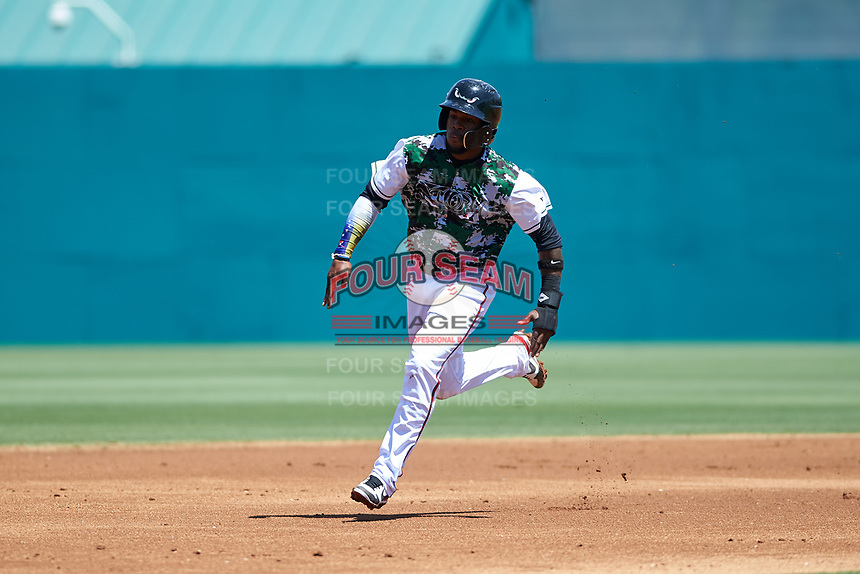 Lake Elsinore Storm first baseman Olivier Basabe (9) hustles towards third base during a California League game against the Inland Empire 66ers on April 14, 2019 at The Diamond in Lake Elsinore, California. Lake Elsinore defeated Inland Empire 5-3. (Zachary Lucy/Four Seam Images)