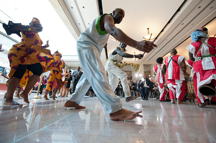 UNITED STATES - July 18: Dancers entertain the crowd  during an event in Capitol Visitor Center Emancipation Hall to honor Nelson Mandela and to celebrate his birthday on July 18, 2013. (Photo By Douglas Graham/CQ Roll Call)