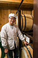 CEO Yoshihiro Wakizaka, Nekka Shochu Distillery, Tadami, Fukushima, Japan, February 20, 2018. The Nekka shochu distillery was founded in July 2016 and at that time was the smallest shochu distillery in Japan. It makes shochu from locally-grown rice, and is helping support a local economy that has languished since the nuclear disaster of 2011.