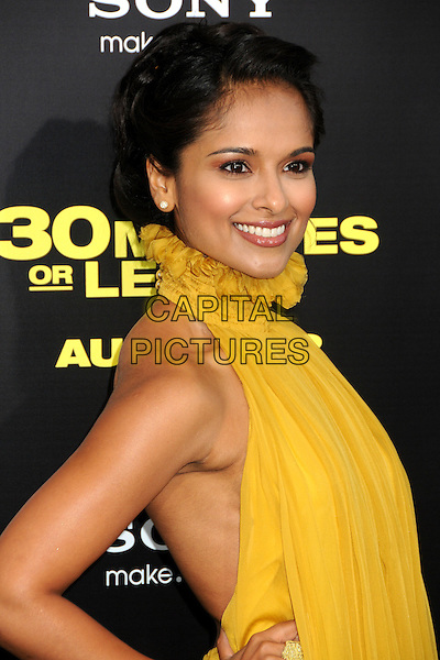 "Dilshad Vadsaria.""30 Minutes or Less"" World Premiere held at Grauman's Chinese Theatre, Hollywood, California, USA..August 8th, 2011.half length yellow dress high collar ruffle .CAP/ADM/BP.©Byron Purvis/AdMedia/Capital Pictures."