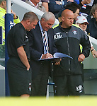 Walter Smith comes down from the directors box to change the Rangers team formation during the second half