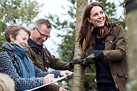 13 May 2019 - Kensington Palace photo dated February 2019 of Duchess of Cambridge with Andree Davies (left) and Adam White (centre), of Davies White Landscape Architect, discussing plans for her, Back To Nature garden, which will be entered at the RHS Chelsea Flower Show this month. The woodland wilderness garden aims to get people back to nature and highlight the benefits of the natural world on physical and mental wellbeing. It will feature a swing seat, a rustic den and a campfire, with a centrepiece of a high platform treehouse. Photo Credit: Kensington Palace NEWS/ALPR/AdMedia