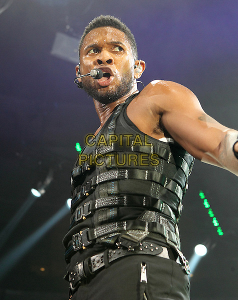 USHER (USHER RAYMOND).performs at the Wells Fargo Center on his OMG Tour, Philadelphia, PA, USA, .December  18th 2010..music concert gig live on stage performing half length black  vest harness buckles microphone singing leather shoulder pads .CAP/RKE/EML.©EML/Rockinexposures//Capital Pictures.