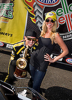 Aug. 4, 2013; Kent, WA, USA: NHRA top fuel dragster driver Morgan Lucas celebrates with wife Katie Lucas after winning the Northwest Nationals at Pacific Raceways. Mandatory Credit: Mark J. Rebilas-USA TODAY Sports