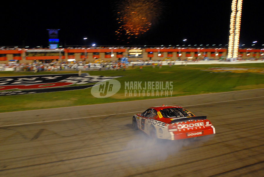Sept. 3, 2006; Fontana, CA, USA; Nascar Nextel Cup driver Kasey Kahne (9) celebrates after winning the Sony HD 500 at California Speedway. Mandatory Credit: Mark J. Rebilas.
