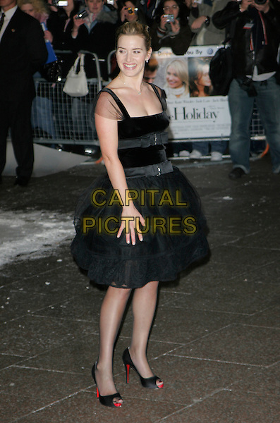 "KATE WINSLET.At the UK Film Premiere of ""The Holiday"", .Odeon Leicester Square, London, England, .December 5th 2006..full length black puffy puffball skirt dress open toe Christian Louboutin shoes red soles.CAP/AH.©Adam Houghton/Capital Pictures"