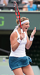 March 29 2016: Timea Bacsinszky (SUI) celebrates after defeating Simone Halep (ROU) at the Miami Open being played at Crandon Park Tennis Center in Miami, Key Biscayne, Florida.