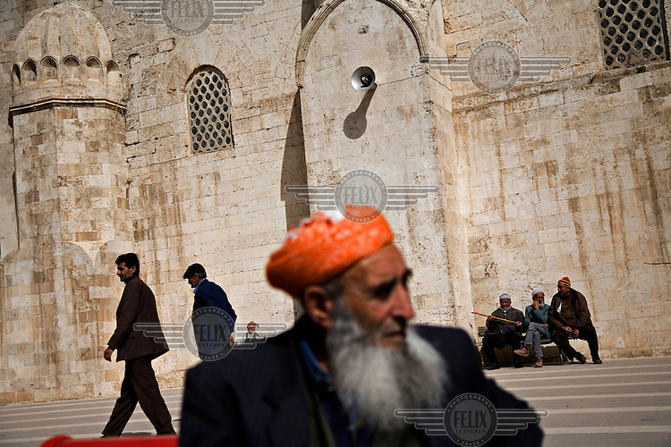 Worshippers wait outside the Selahaddin Eyyubi Mosque in Silvan. The mosque is named after Selahaddin Eyyubi, the famous Kurdish commander.
