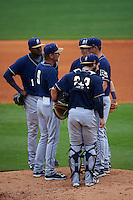 San Antonio Missions manager Jamie Quirk (9) talks with pitcher Ryan Butler (30) and (L-R) Duanel Jones (17), Trea Turner (4) and Jason Hagerty (22) during a game against the NW Arkansas Naturals on May 31, 2015 at Arvest Ballpark in Springdale, Arkansas.  NW Arkansas defeated San Antonio 3-1.  (Mike Janes/Four Seam Images)